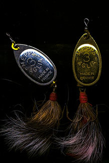 Two fishing lures with squirrel-tail dressing are shown.