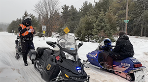 Conservation officer snowmobile patrol
