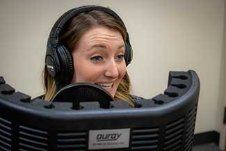 Rachel Leightner recording a podcast.