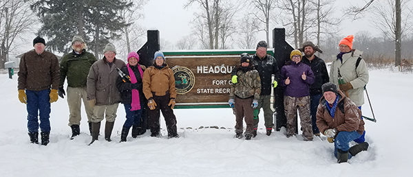 Group of stewardship volunteers on snowy day