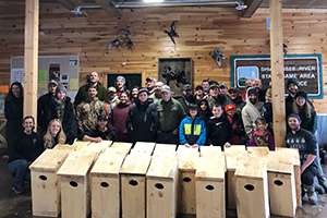 Group of volunteers with wood duck boxes