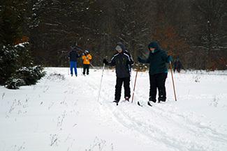 Ski for Light participants talk along the ski trails.