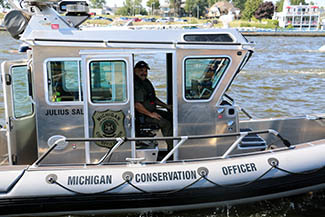 Conservation officer Ivan Perez is shown in a fishing safe boat.