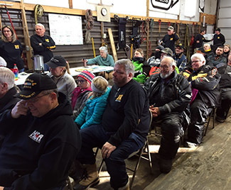 A gathered crowd listens to presentations at the Haywire Grade's 50th anniversary snowmobile ride.