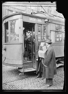 A historic photo shows street car riders wearing masks during the 1918 influenza epidemic.