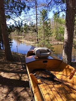 A drift boat sits waiting and ready for a trip on the Manistee River.