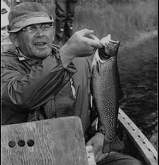 A historic photo shows Clarence Roberts with one of his many trout catches.