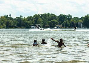 Kids swimming in the lake