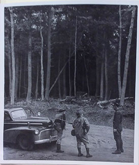 Visitors to the Porcupine Mountains look at the tall trees in October 1944.