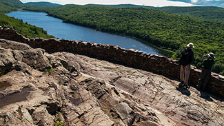 Visitors are shown at the Lake of the Clouds overlook, the signature attraction at Porcupine Mountains Wilderness State Park.