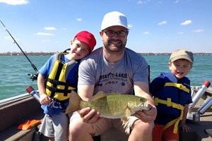 Brad Utrup, who works in the DNR Fisheries Division's Research Section, shows off a fish he and his young sons caught