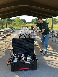 DNR resource analyst Nick Dohm prepares for a drone flight in this photo.