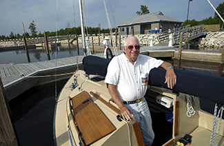 A gentleman is pictured in his boat moored at the Cedar River Harbor in Menominee County.