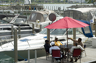 Boaters enjoy a chance to relax off-water at Milliken State Harbor in Detroit.