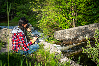 A mother and son enjoy an outing fishing at Hoeft State Park.