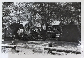 Campers and picnickers enjoy a day at Otsego Lake State Park in this undated historical photo.