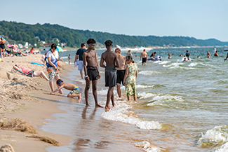 Visitors enjoy the beach at Grand Haven State Park.