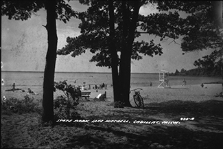 A historical photo shows visitors at the beach at William Mitchell State Park in Wexford County.