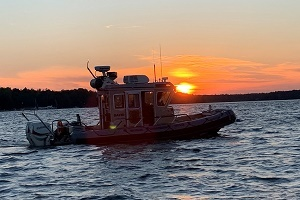DNR patrol boat on the water at sunset
