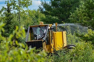 Herbicide is sprayed from a skidder in Marquette County.