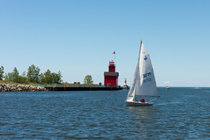 Holland State Park lighthouse and sail boat