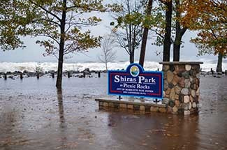 A flooded and storm-damaged Shiras Park is shown in Marquette after an October 2017 storm on Lake Superior.