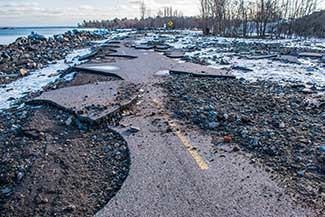 A springtime 2020 photo shows severely cracked pavement along Lakeshore Boulevard in Marquette.