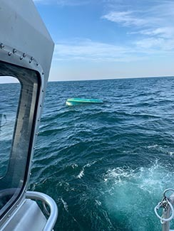 The U.S. Coast Guard finds an overturned boat in July. Two boaters were rescued.