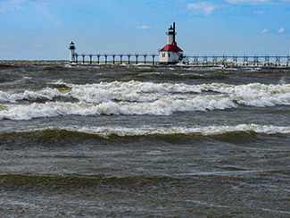 High water at South Haven overflows a pier.