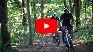 A video link play button to a mountain biking video.