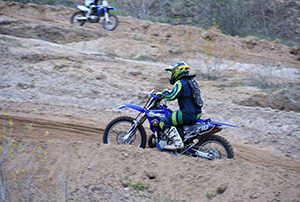 Two motorcycles riding at Holly Oaks ORV Park