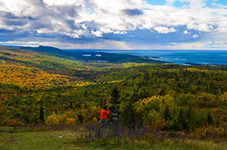 A stunning view of Lake Superior and the Keweenaw Peninsula from Brockway Mountain is shown.