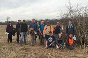 group of park stewardship volunteers in a field