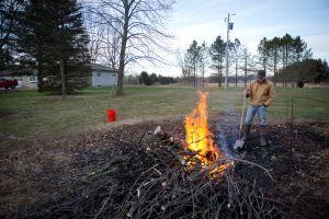 A man burns yard debris.