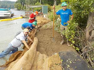 contractors and volunteers create fisheries habitat