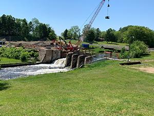 heavy equipment removing dam
