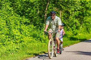 family riding bikes on Nakwema Trailway