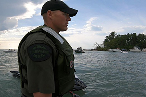 male conservation officer patrolling Lake St. Clair