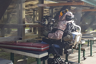 Man in wheelchair target shooting at Sharonville shooting range