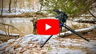 A video still frame image of a man steelhead fishing in a river