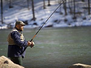 man steelhead fishing in river