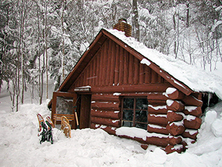 A wintry scene is shown from the Mirror Lake Cabin.