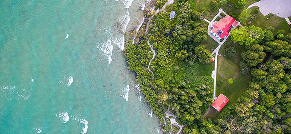 aerial view of shoreline and lighthouse at Leelanau State Park
