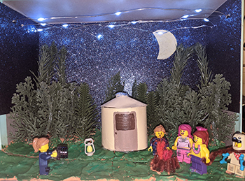 diorama with Lego figures in a campground yurt scene