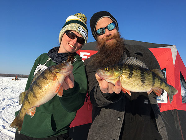 Story author Jennifer Johnson and her husband, Andrew hold up jumbo perch they caught on Lake Gogebic.