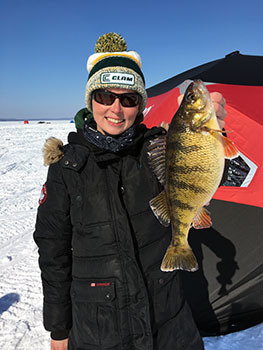 Story author Jennifer Johnson holds up a jumbo perch she caught on Lake Gogebic.