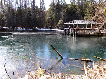 Ice locks in the raft and coats the surface of The Big Spring at Palms Book State Park in Schoolcraft County.