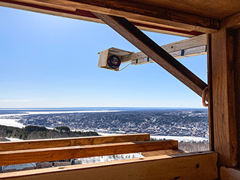 A bird's eye view of the surrounding landscape is shown from inside a nest box installed at the Quincy Mine.