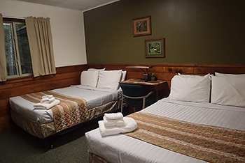 Room with two double beds in RAM Center Superior Lodge