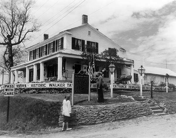 A Michigan historical marker is visible in this historic photo of the Walker Tavern.